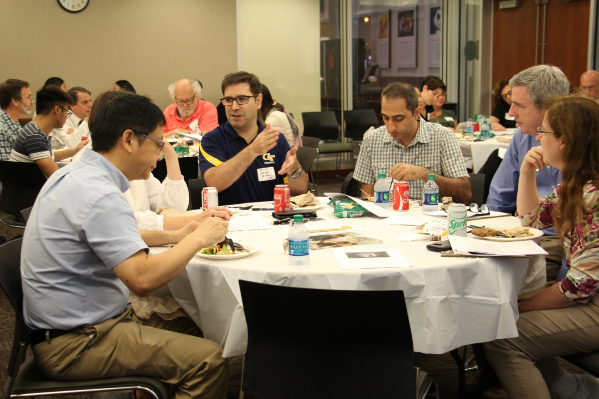 A group of faculty engage in a discussion during a teaching workshop